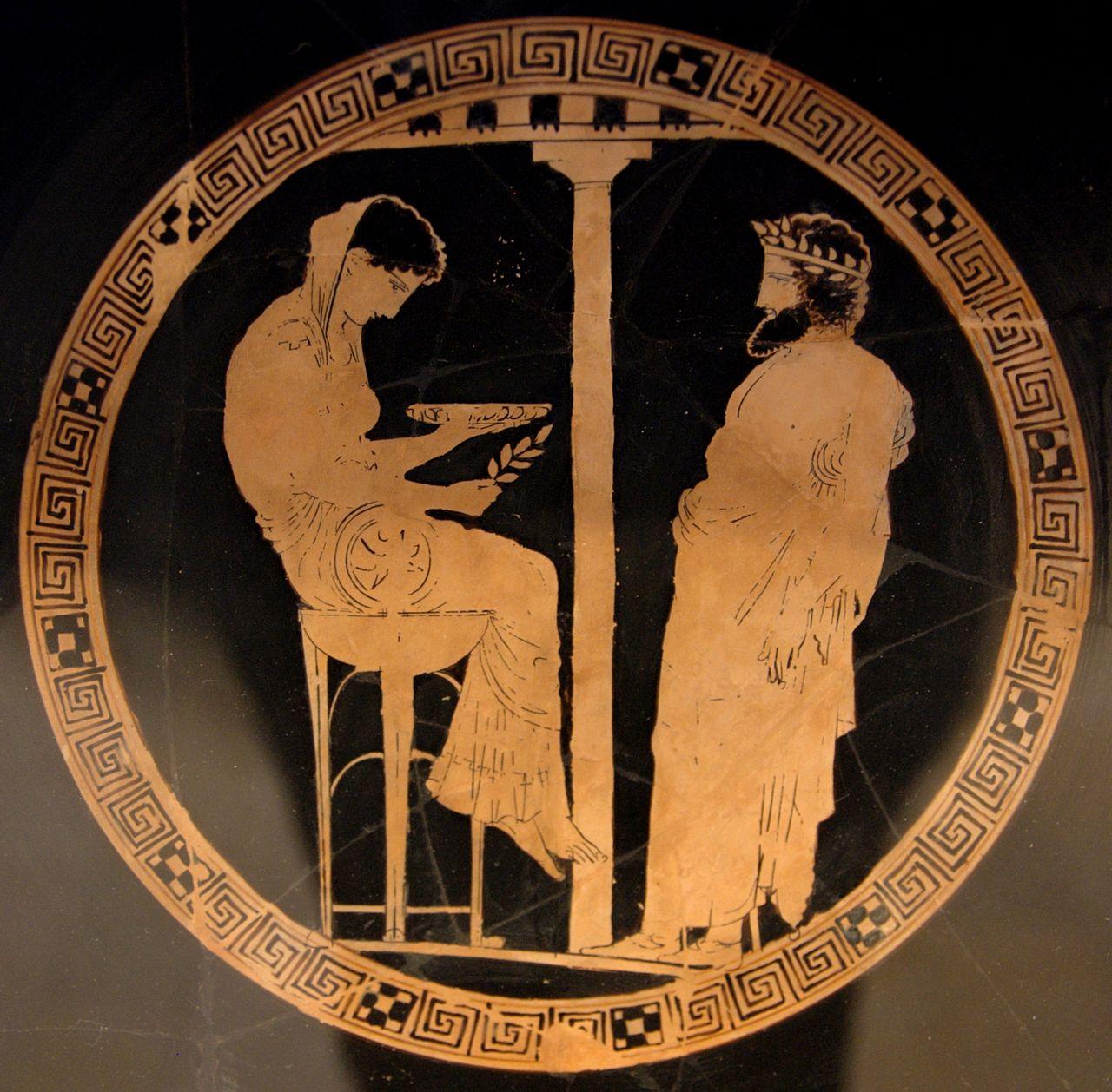 Фемида в роли Пифии вещает Эгею (аттич. килик, ок. 440—430 гг. до н. э.)