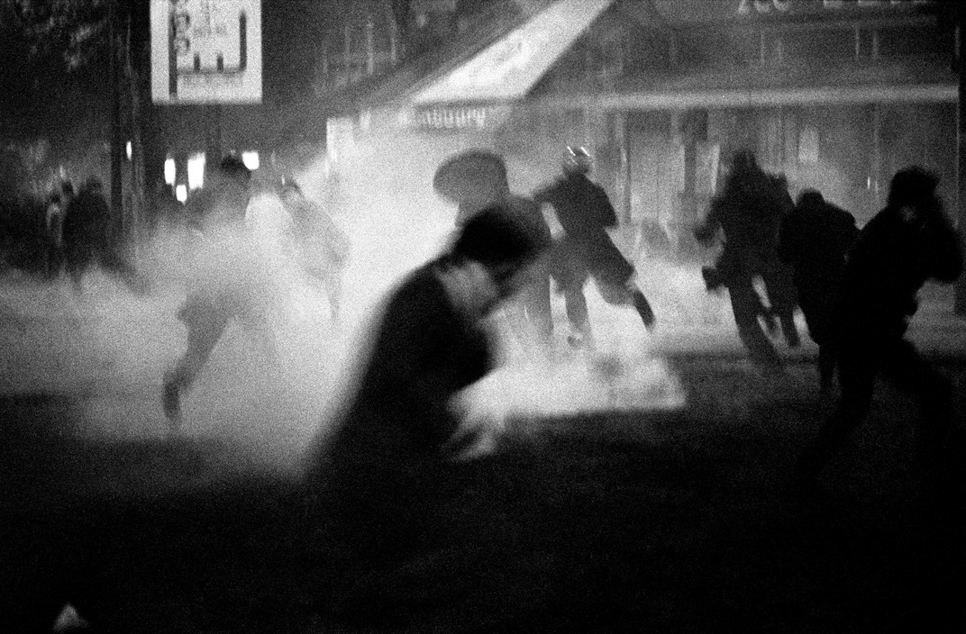 Bruno Barbey. Night between the 10th and the 11th of May 1968. Boulevard St. Michel. Explosion of teargas.