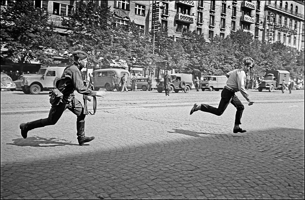 Ian Berry. Czechoslovakia. Prague. A Russian soldier chases a Czech man in Wenceslas Square. 1968
