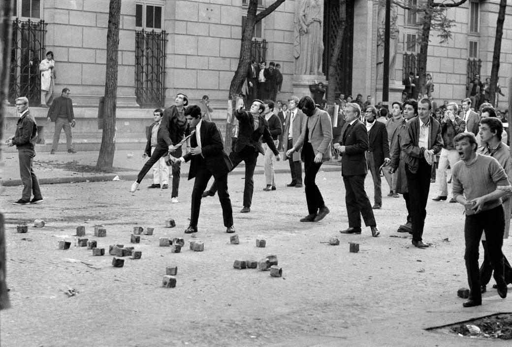 Bruno Barbey. Demonstrators with rocks in front of the Medecine University boulevard Saint Germain. 1968
