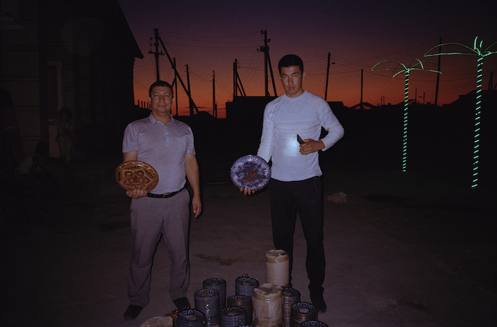Photos by Olga Shurygina. Residents of Muynak with plates they collected for the project, 2019