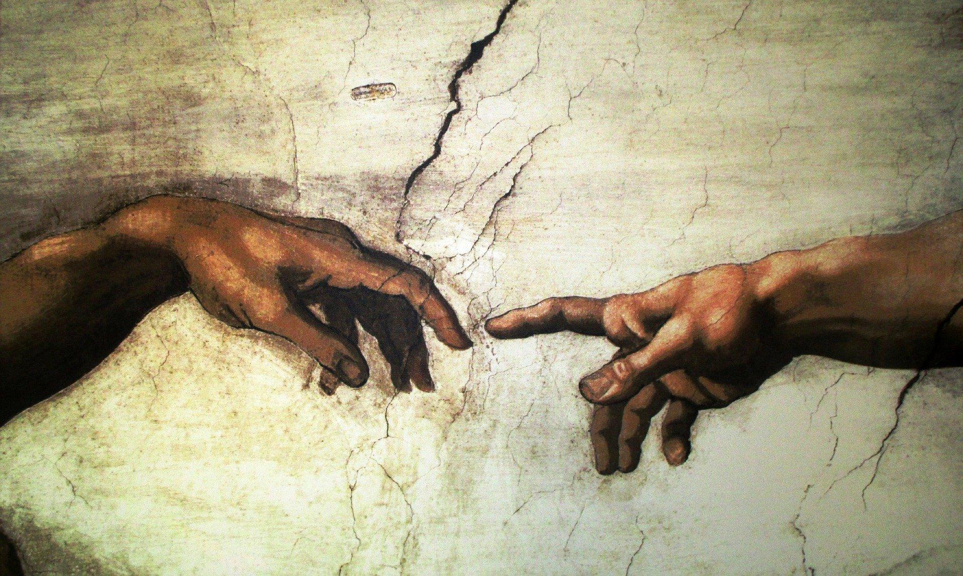 Фрагмент фрески Микеланджело«Сотворение Адама», написанной около 1511 г.