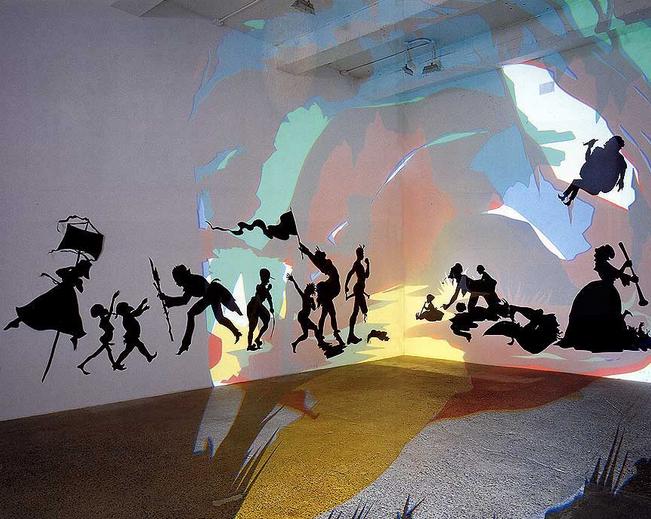 Кара Уокер. Darkytown Rebellion. 2001 г. Инсталляция. Бумага, проекция. 427 х 1127. Музей современного искусства Великого