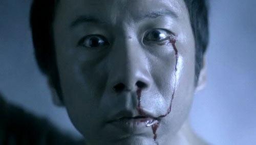 <i>Цукамото в роли «0» в «Кошмарном детективе», 2006</i>